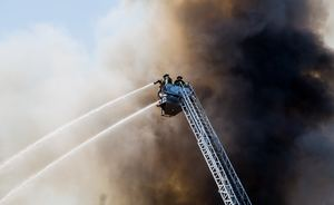 Firefighters tackle a blaze; an occurrence becoming more common as the climate changes.