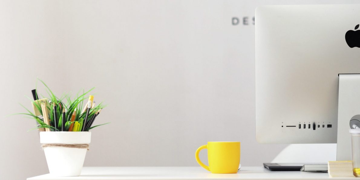 branding page header image. Creative studio desk with planet, coffee cup and plant pencil pot