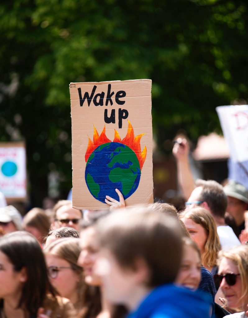 climate strike body image 1 - wake up the earth is on fire sign