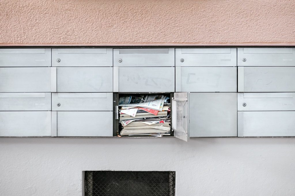 sustainability and mental health body image 3 locker with one open and full of junk mail