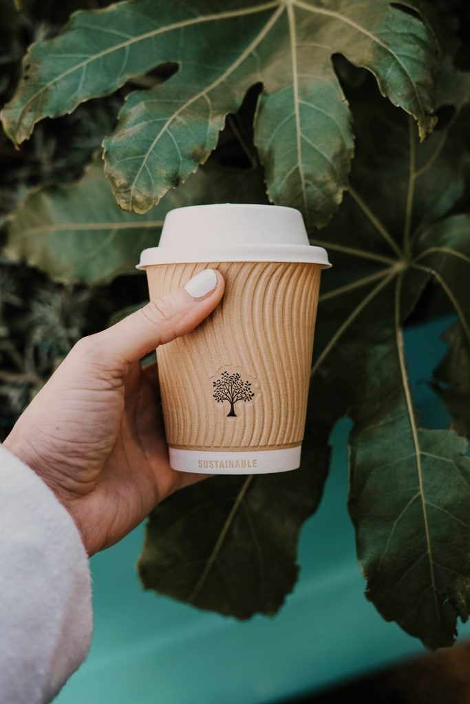 Holding a sustainable cup of coffee