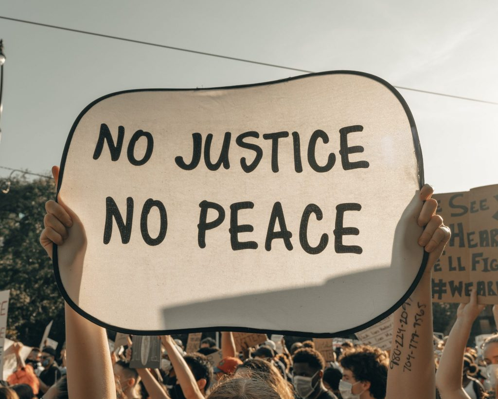 No justice no peace sign at a rally for equality