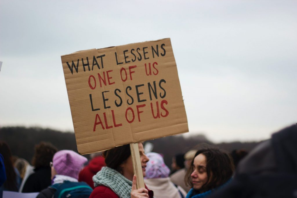 what lessens one of us, lessens all of us banner at a really for equality