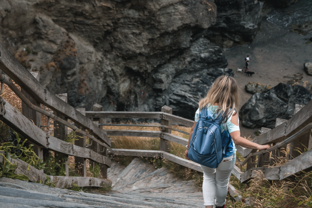 A tourist area in Cornwall. Woman walking down the steps towards the future of the visitor economy