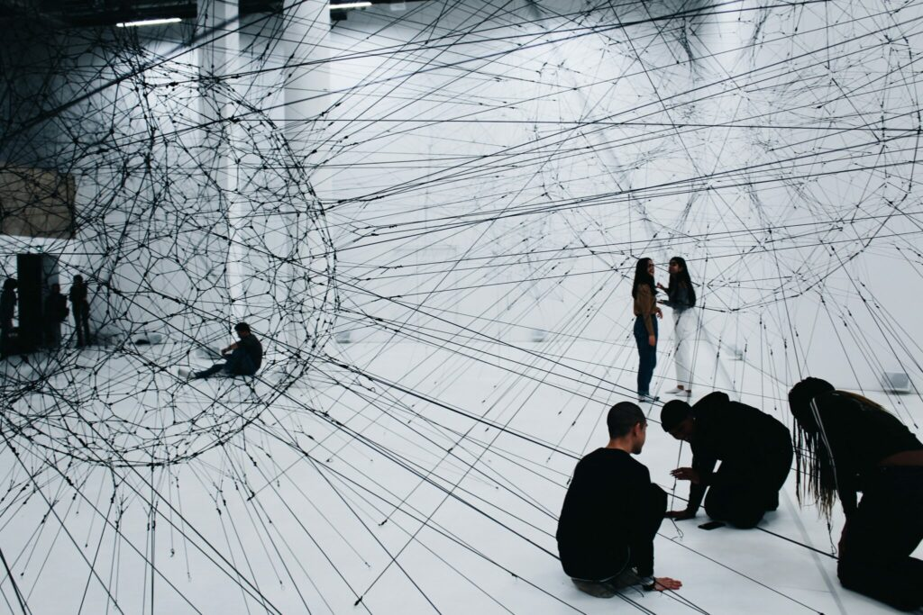 An immersive exhibition at a museum with people interacting with the art